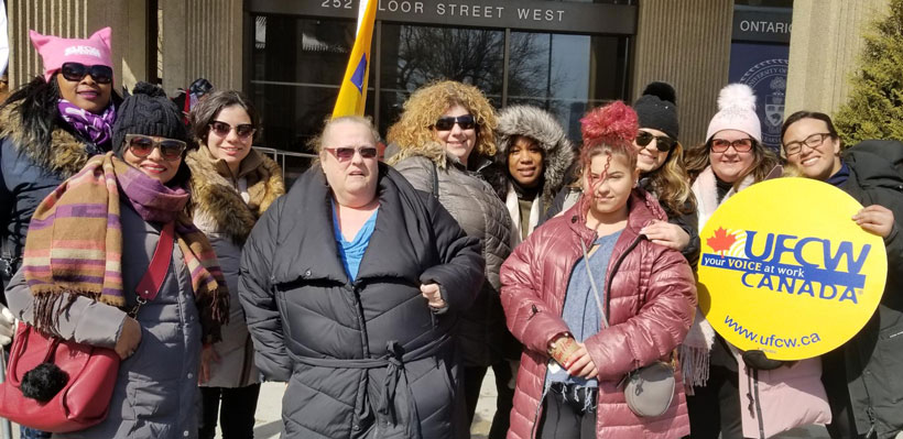 Local 1006A members march together for International Women's Day in Toronto.
